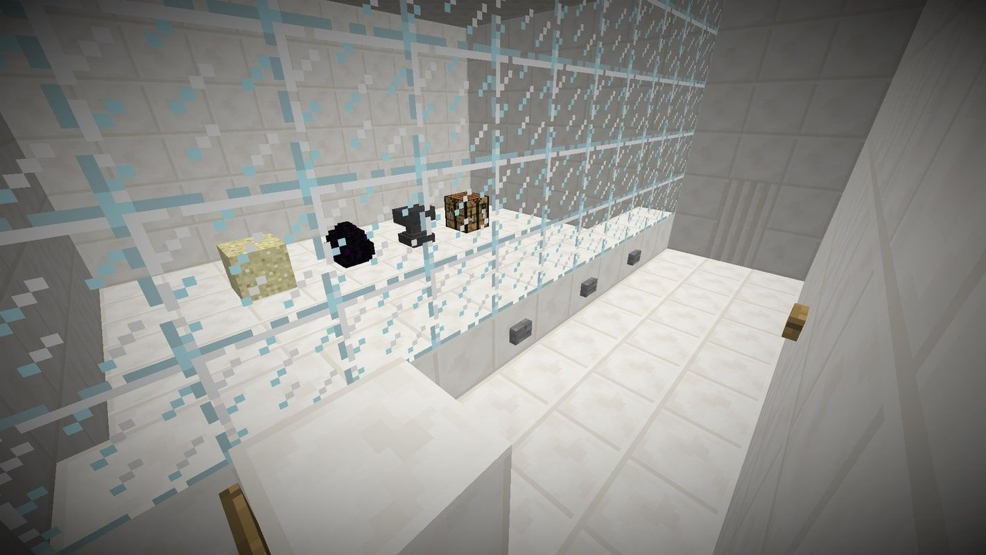 A screenshot from the map showing one of the levels with a block of sand, a dragon egg, an anvil, and a crafting table